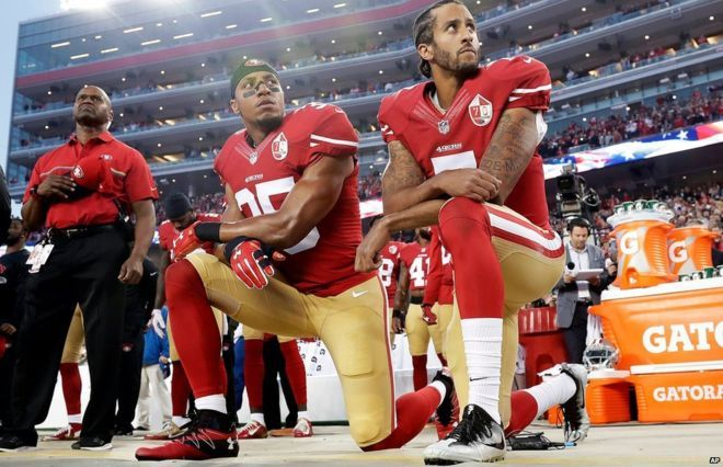 San Francisco 49ers safety Eric Reid and quarterback Colin Kaepernick kneel during the national anthem before an NFL football game on 13 September