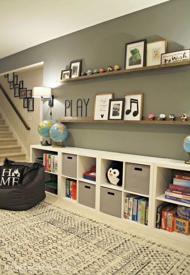 Huge Empty Wall Transformed Into Pretty Game And Toy Storage With Images Home Decor Home Basement Decor