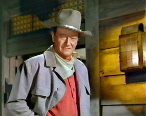 """El Dorado""...John Wayne to Robert Mitchum...""I'm looking at a drunk...with a tin star pinned on it."""