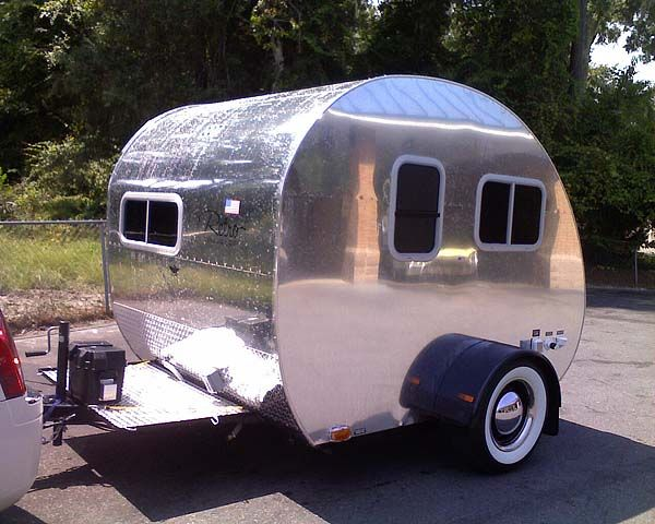 2010 Retro Traveller: ten feet long, all aluminum body, has AC, electric fridge, toilet & shower, radio/CD stereo system, satellite TV receiver, dual battery system and exterior hookups.