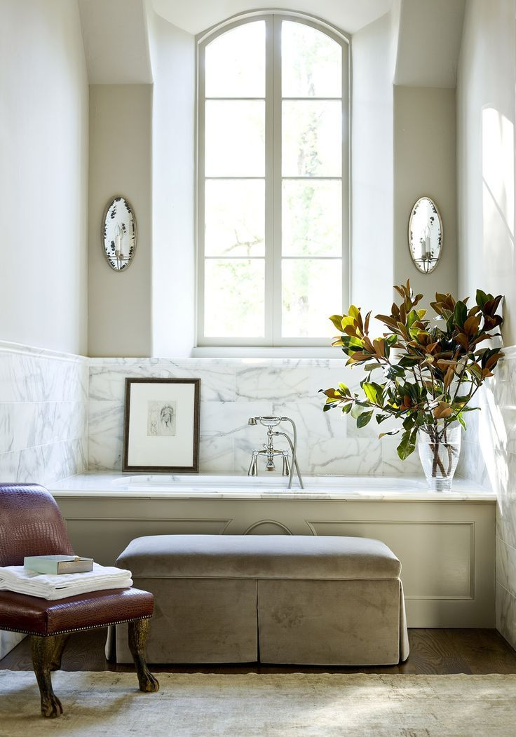 beautiful bathroom... I really like the marble, and that they put magnolia tree branches in a vase.