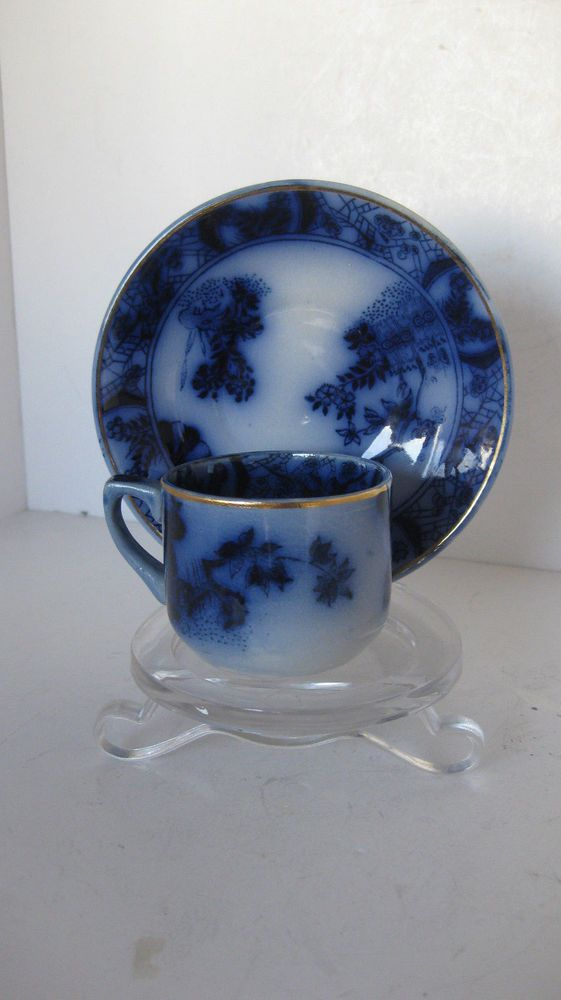 Flow blue coffee cup and saucer - Earthenware Sacavem Portugal