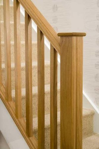 Contemporary square range in oak with square spindles, newels and flat caps
