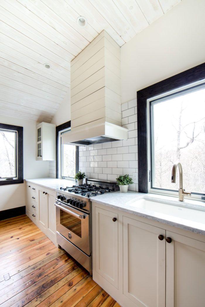 Neutral Kitchen With Black Trim Windows And White Subway