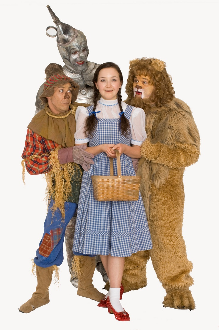 Dorothy (Maeve Coleen Moynihan), Scarecrow (Dean Holt), Lion (Reed Sigmund) and the Tin Man (Max Wojtanowicz) prepare to see the wizard! Children's Theatre Company's 2011-2012 production of The Wizard of Oz. Photo by Joan Buccina.