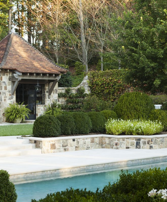 Beautiful Traditional Pool Landscaping With Boxwoods.