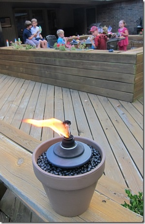 Make your own torches...terra cotta pot, dried black beans and citronella tike refill