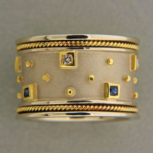 Wide band ring with tiny inset stones!