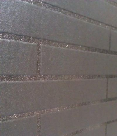 Sparkle (20-295) - Graham and Brown Wallpapers - Glitter embellishments have been used to accentuate the grout line creating a sophisticated and stylish small scale tile effect. Black brick vinyl wallpaper. Please request a sample for true colour match. Other colour ways available.