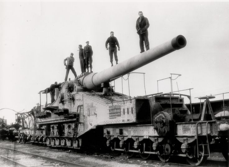 """This is a German 240mm Rail Gun, captured by American soldiers in the spring of 1945. The Germany Army utilized many rail guns such as this, hiding them in tunnels during the day to avoid aerial attack and rolling them out to fire at night. As large as this gun seems, the biggest rail gun used by the Germans (and one of the largest guns in history) was a 800mm gun called """"Schwerer Gustav."""""""