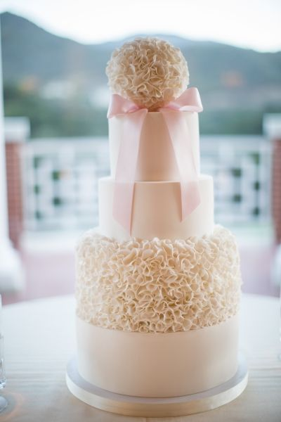 Fondant Ruffled Wedding Cake by Frost It Cakery. Photo by The Argus Image