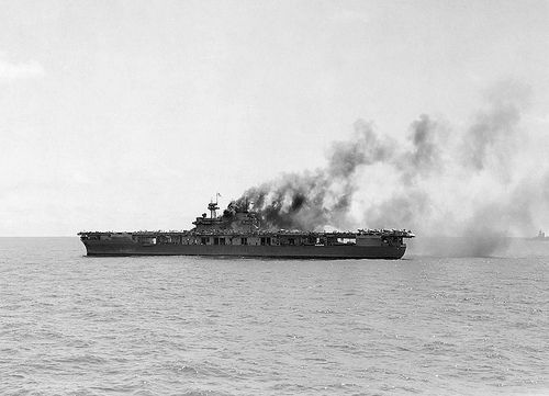USS Yorktown (CV-5)  American aircraft carrier Yorktown (USS Yorktown (CV-5), damaged by Japanese bombers during the battle of Midway 0n 4th June 1942.  Photo taken from American heavy cruiser Astoria (USS Astoria (CA-34).