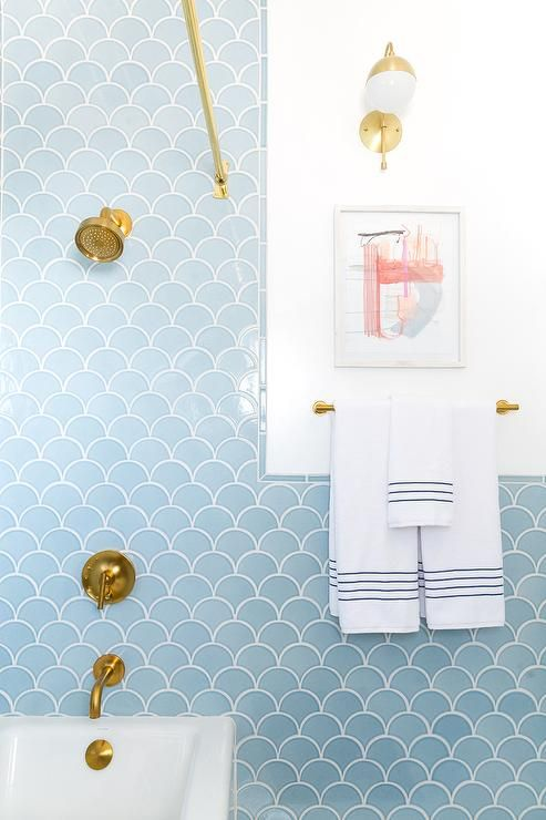 Blue And Gold Bathroom Boasts A Drop In Tub Accented With Fan Tiles Fireclay