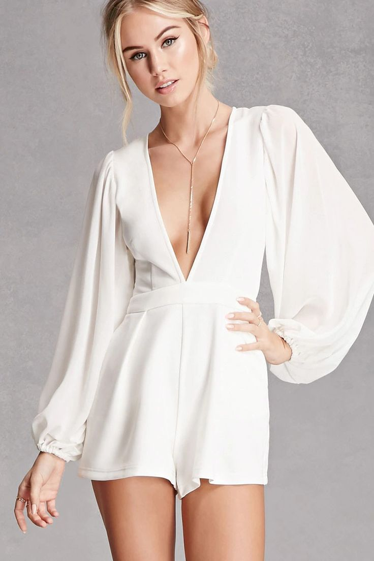 This romper by Selfie Leslie™ features a stretch-knit body with a plunging V-neckline, flared silhouette, long mesh-knit puff sleeves, on-seam pockets, and a concealed back zipper.