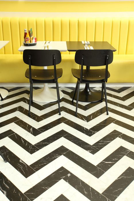 yellow, black and white tile floor