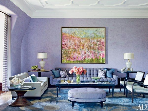 Tones recalling amethyst, sapphire, opal, and turquoise set a moody atmosphere in a New York apartment decorated by Drake Design Assoc. The family room's Venetian-plaster walls were executed by the Alpha Workshops in a Benjamin Moore purple; beneath a Wolf Kahn painting are a William Haines Designs sofa and a Lucien Rollin Collection ottoman. Christian Liaigre designed the club chair, and the armchairs are by Holly Hunt. The oval side table in the foreground is from Karl Kemp Antiques, the…