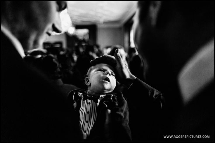Fantastically well dressed young guest at the black tie wedding reception -