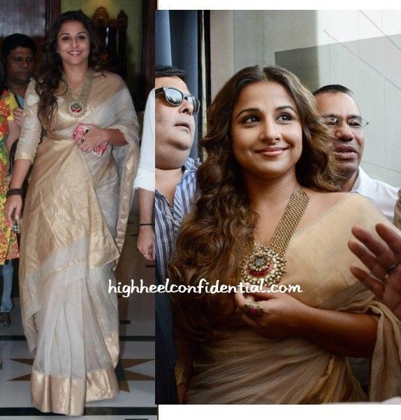 Two back to back promotional appearances for HAK saw Ms. Balan in her signature look: a simple sari, a rudraksha beads bracelet and a statement necklace. Of the two looks here, prefer her in the black and silver look or in the white and gold one? P.s. The black sari is an Anavila. Photo Credit: …