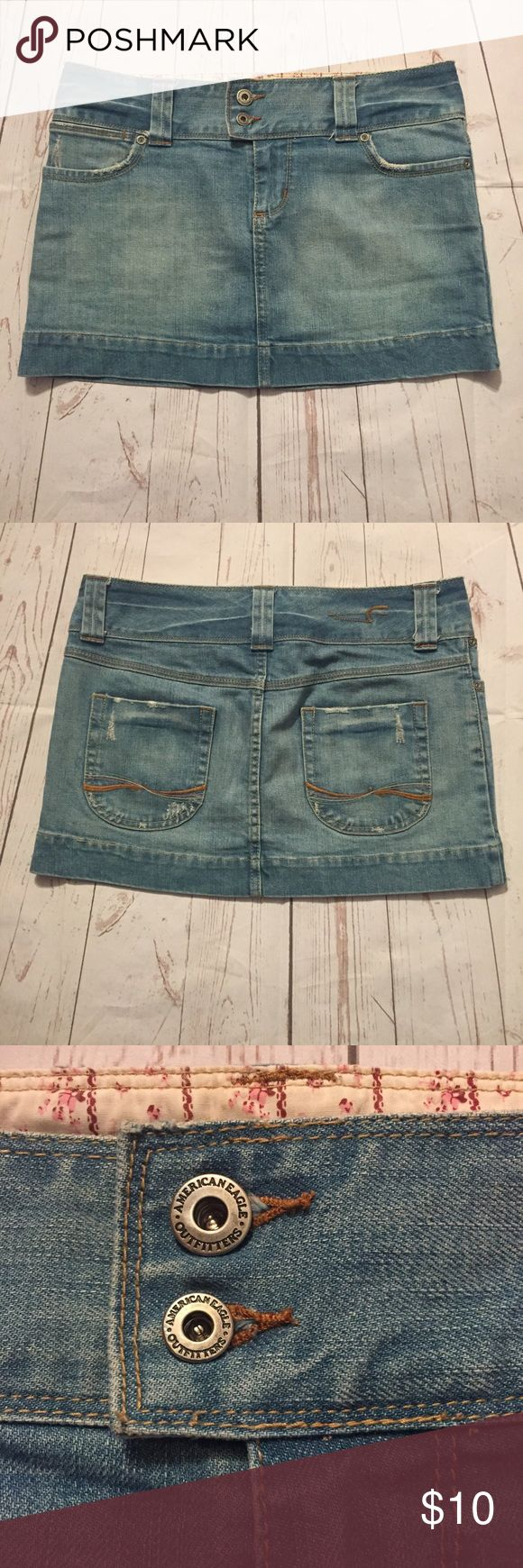 American Eagle mini Jean distressed skirt SZ 2 American Eagle Outfitters light wash distressed jean mini skirt SZ 2 waist: 16 length: 12 1/2 Preowned small stain in front see last picture American Eagle Outfitters Skirts Mini