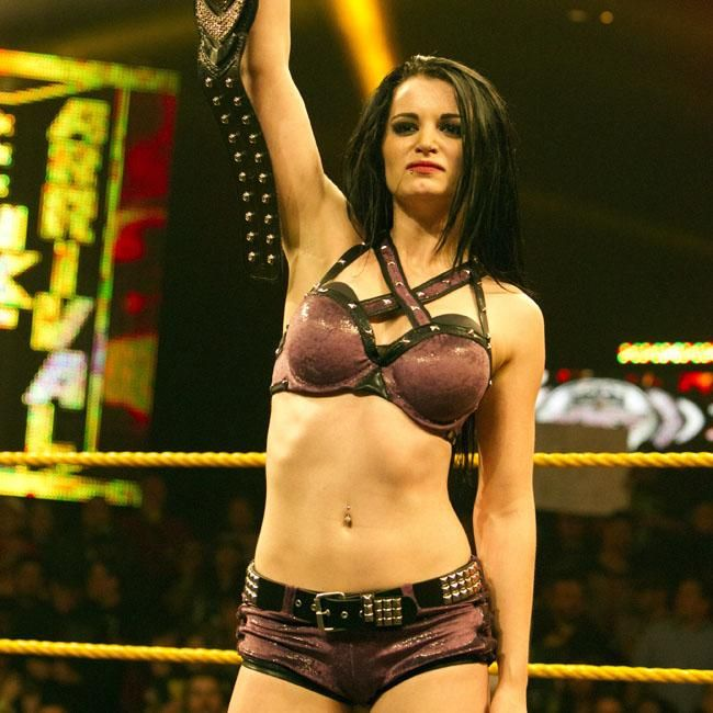 WWE 'Total Divas' star Paige and her boyfriend and fellow wrestler Alberto Del Rio have been suspended for violation of the company's talent wellness policy.