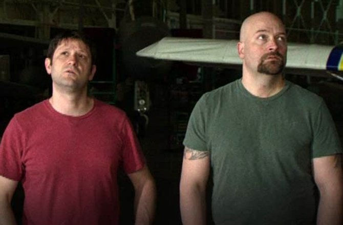 Grant Wilson, left, and Jason Hawes are shown above looking for paranormal activity in a Ghost Hunters episode shot at Pearl Harbor. They spent time last week investigating at the former Missouri State Penitentiary in Jefferson City for an upcoming episode of their Syfy channel series. (Ghost Hunters/SyFy.com photo)