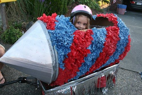Make your own 4th of July parade float, like this crepe paper-covered rocket that rides atop a wagon.