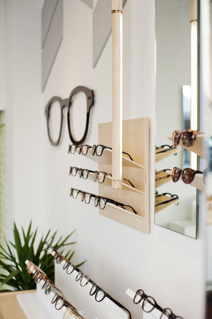 The 550 square foot flagship shop for Australian eyewear brand Bailey Nelson. The shallow depth of the heritage building called for a design where the entire shop would serve as a window display as well as a merchandising space. Custom cut chevron wall tiles allow the uneven plaster wall to highlight the history of the building. Custom designed display units keep the frames aligned and the shop looking tidy.