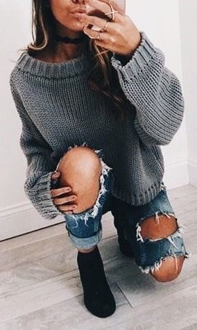 Cute gray sweater with distressed denim jeans and black suede boots.