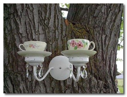 teacup bird feeder...another idea --make a sconce on a tree with solar lights instead of teacups!