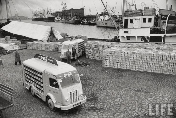 coca-cola shipment being unloaded in helsinki, finland for the July 1952 Olympic games