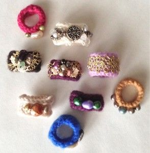 Make little wool rings from orphan gloves from mrspollyrogers.com.  Video, too!