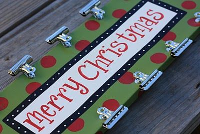 christmas card holder. This is exactly what I'm doing with the Dollar Tree Christmas sign I bought that looks similar to this.