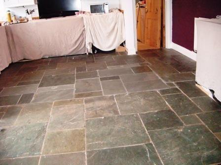 Abused Slate Tiled Kitchen Floor In Melton Mowbray .