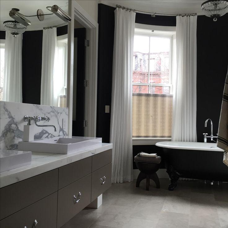 Luxurious Master Bathroom black bathtub black walls drapery in bathroom marble backsplash wall mounted faucet