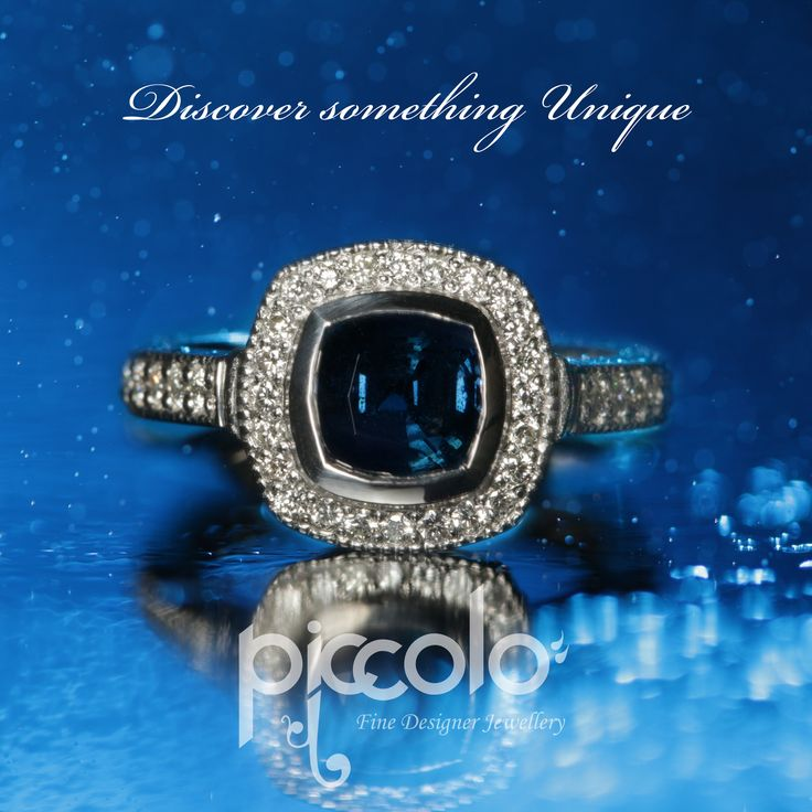 "Adele | ""The heart wants what it wants"" Blue Sapphire surrounded with a halo of small Diamonds set in Platinum for a very special wedding anniversary gift For your unique Wedding Ring design book your free consultation 