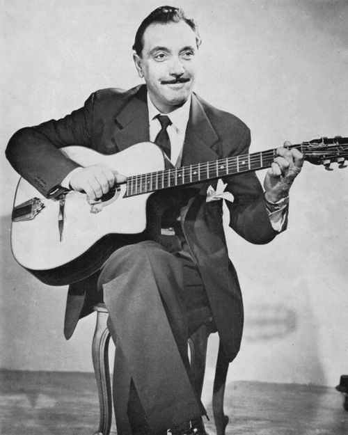 Django Reinhardt - A French, Guitarist and Composer :: Django is often regarded as one of the greatest guitar players of all time. His third and fourth fingers were paralyzed, and he played with only his index and middle finger, creating a new technique for jazz guitar playing. #GraveyardGreats #DjangoReinhardt