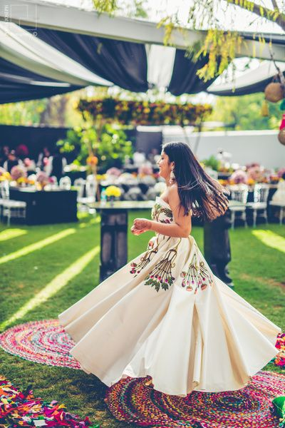Cocktail Outfits - White Gown with Green and Pink Embroidered Boddice | WedMeGood #wedmegood #indianwedding #indianbride #cocktailoutfits #gown #indiangown #twirling