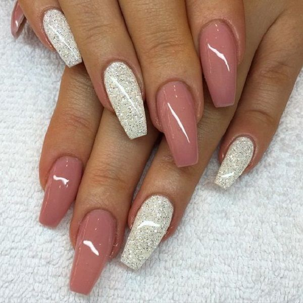 Nude Pink with Silver Glitter on Coffin Nails. Silver glitter is always a great combination with each and every color on the Earth. With the nude pink,silver glitter is saying 1000 words.