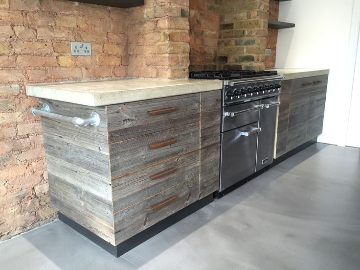 Bespoke kitchen installed in London. Materials used: polished concrete Worktops, reclaimed wood, Falcon oven range