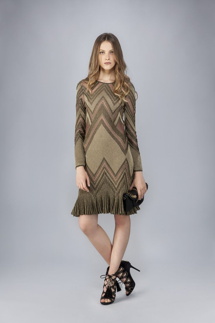 Long-sleeve backless knitted dress, with geometric pattern, knitted insert, viscose and lurex.<br>Made in Italy<br>The model's measurements are:<br>Height 173cm, Bust 84cm, Waist 60cm, Hips 85cm which generally refers to a size 40