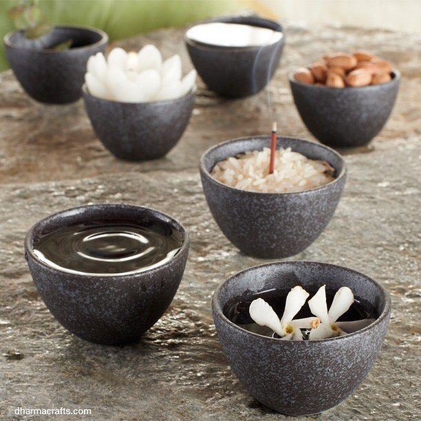 In Buddhist tradition, a seven bowl offering set may be placed on the  altar for water, flowers, incense, light, perfume, food, and music,  or other traditional offerings.
