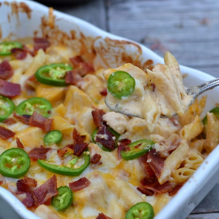 Life just tastes great with jalapenos in it. Now add cheese, chicken and bacon and my goodness life just got so much sweeter! Look at all that creamy goodness. This casserole is quick t...
