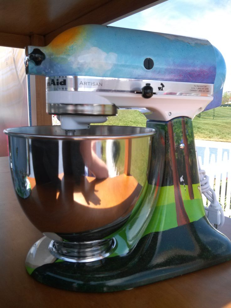 www.AuctionToday.co  KitchenAid stand mixer, autographed by pro golfer Hale Irwin and painted by Ken Hank, that was auctioned off at the 75th Senior PGA Golf Championship in Benton Harbor, MI.  The theme is inspired by a beautiful sunny day on the course.