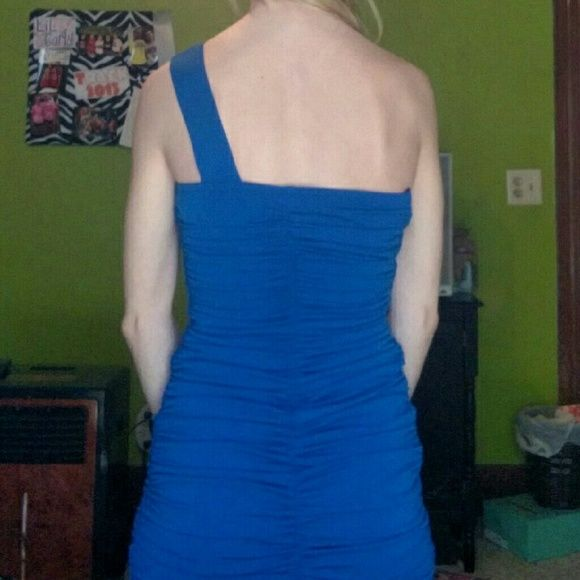 Blue homecoming dress Tight fit thigh length royal blue dress with one shoulder jewels. Worn once to a dance and it's super comfy! Dresses One Shoulder