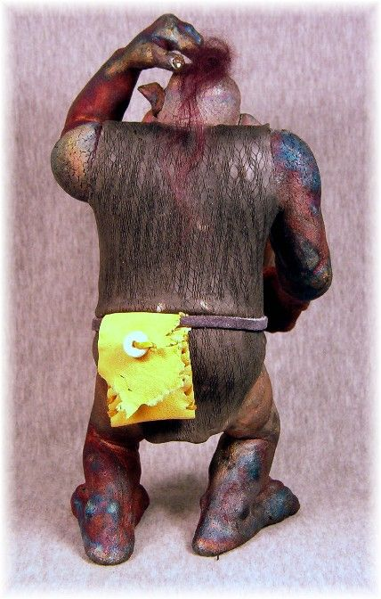 Back view of Ogre #2 Whort, with his leather pouch on his suede belt. Fantasy Raku Sculpture