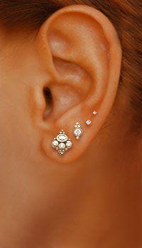 Jewelry by Maria Tash; 18K Diamond MT Crown Studs (bottom), 18K 4 Diamond Scalloped Bezel Trinity Earstuds (center)
