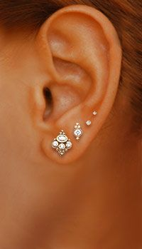 Venus by Maria Tash . diamond crown and diamond scalloped edge earstuds