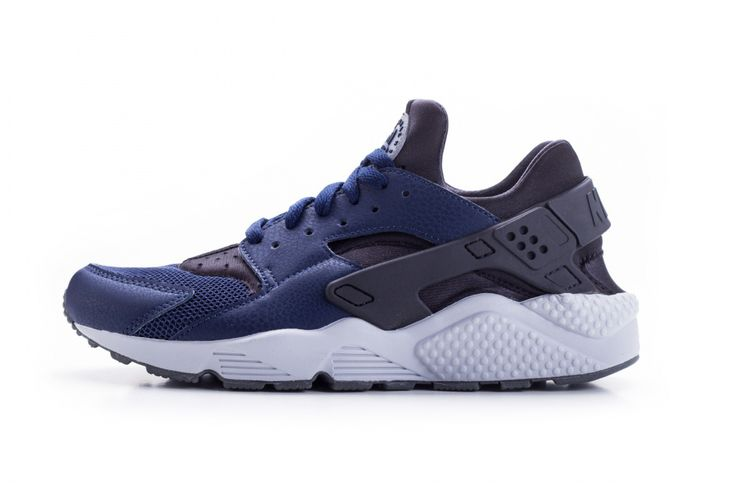 Midnight navy blue and dark ash grey tones on the classic runner.