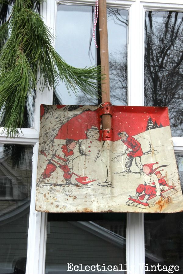 An old childrens snow shovel as a door decoration. Genius. #12daysofchristmas