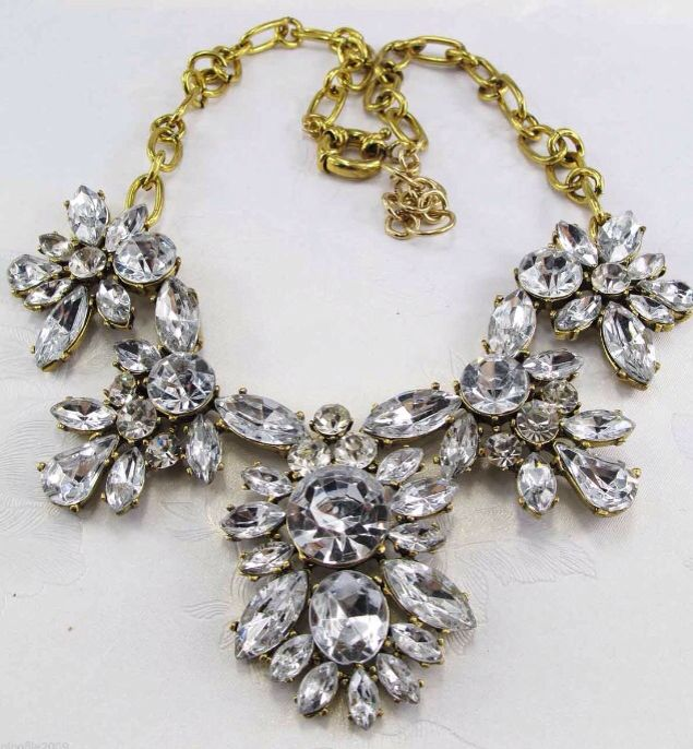 Golden and clear crystal necklace.